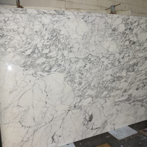 natural slab, marble, bookmatch, backsplash, bathroom, fireplace stone, countertops, bar top, patio wall, fireplace surround, shower surround